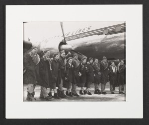 Photograph of Canadian Olympic Team Members, Cortina d'Ampezzo, Winter Olympic Games, 1956.  Frank J. Shaughnessy Jr., Chef de Mission, is 7th from the right.