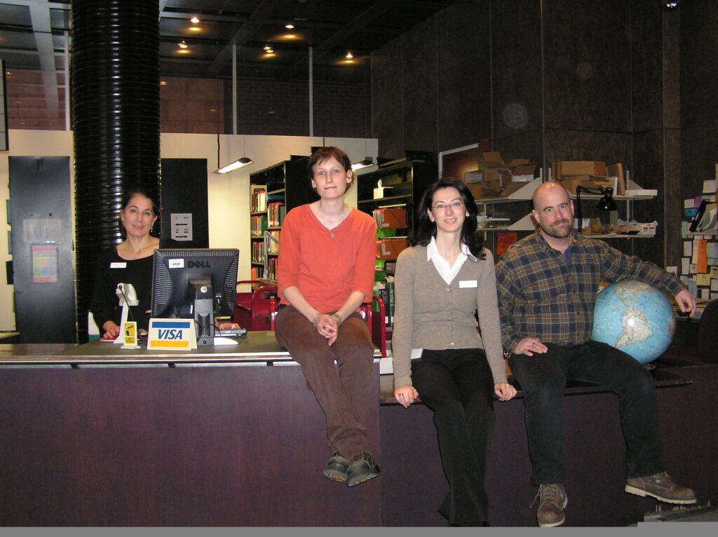 At the Gelber circulation desk, circa 2007.  From L to R: Anne Avery, Lisa Barrett, Mila Bozic Erkic, and Brock Cummings