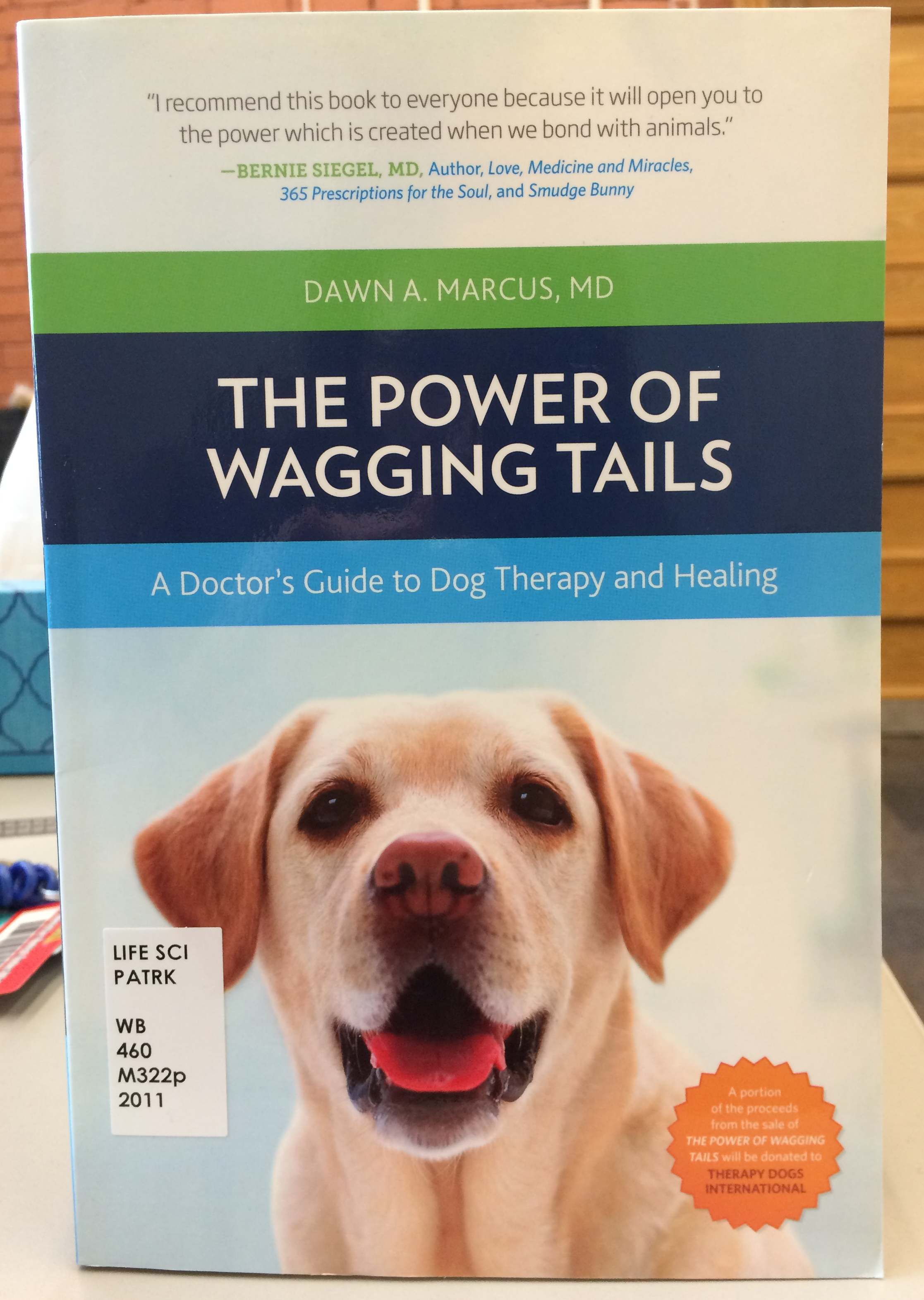 The Power of Wagging Tails: A Doctors Guide to Dog Therapy and Healing